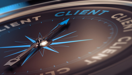 Compass with needle pointing the word client, concept image to illustrate CRM, customer relationship management.